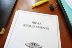 HIPAA regulations folder on desk with pen