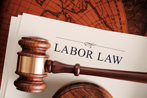 Legal Mallet resting on Labor Law document